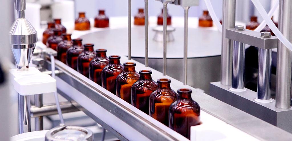 sterile bottles on conveyor belt